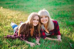 Two beautiful young women having fun outdoors stock photos