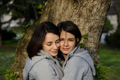Two beautiful young women hugging outside Royalty Free Stock Photo