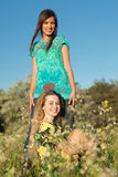 Two Beautiful Young Women In Blooming Meadow Stock Image