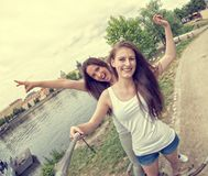 Two beautiful young women making selfie Royalty Free Stock Photography