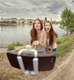 Two beautiful young women making selfie and grimacing Stock Photo