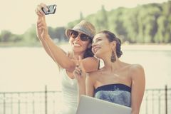 Two beautiful young women making selfie laughing Royalty Free Stock Photography