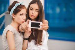 Two beautiful young women making selfie photo Stock Image