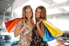 Two Beautiful Young Women in a Mall Royalty Free Stock Images