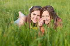Two Beautiful young women outdoors happy smiling Royalty Free Stock Images