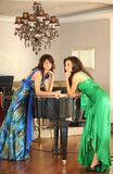 Two beautiful young women at a piano Stock Photos