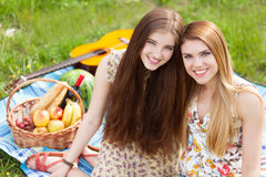 Two beautiful young women on a picnic Royalty Free Stock Images