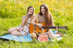 Two beautiful young women on a picnic Royalty Free Stock Photo