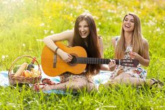Two beautiful young women on a picnic Royalty Free Stock Image