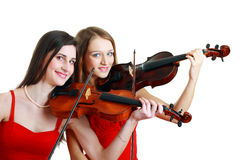 Two woman play violin Stock Photo