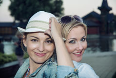 Two beautiful young women posing in front of camera Stock Photo