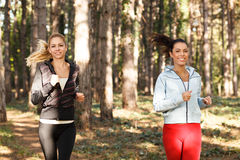 Two beautiful young women running Royalty Free Stock Image