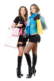 Two beautiful young women after shopping Stock Photography