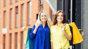 Two beautiful young women with shopping bags Stock Photos