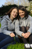 Two Beautiful Young Women Smiling In a Park Royalty Free Stock Images