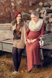 Two beautiful young women. Talk about pregnancy Stock Image