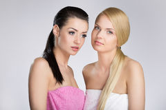 Two beautiful young women in towels royalty free stock image