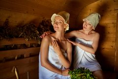 Two girls relaxing in sauna Royalty Free Stock Photography