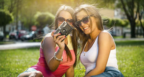 Two beautiful young women using a vintage camera Stock Photography