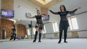Two beautifull caucasian women in costumes for belly-dance dancing stock footage