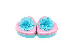Two beautifully decorated heart shape containers in pastel color Stock Photo