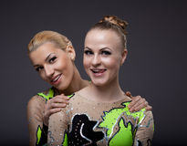 Two beauty acrobats woman friendly portrait Royalty Free Stock Photography