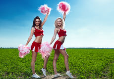 Two beauty cheerleader Stock Images