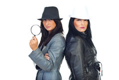 Two beauty detectives women Stock Photos