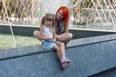 Two beauty girls on fountain Stock Images
