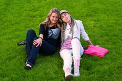 Two beauty girls on grass Stock Photo