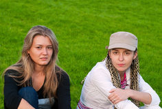 Two beauty girls on grass Royalty Free Stock Image