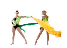 Two beauty gymnasts fight with flying fabric Royalty Free Stock Photo