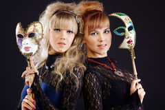 Two beauty sisters with mask Stock Image