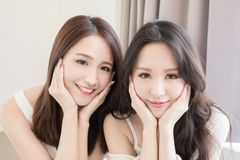 Two beauty woman in home Stock Image