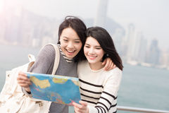 Two beauty woman look map Stock Image