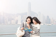 Two beauty woman look map Royalty Free Stock Photography