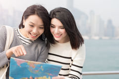 Two beauty woman look map Royalty Free Stock Image