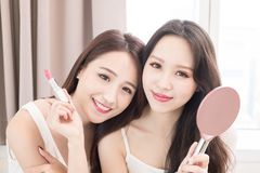 Two beauty woman in room Stock Photography