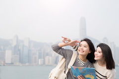 Two beauty woman take map Royalty Free Stock Images