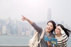 Two beauty woman take map Stock Image