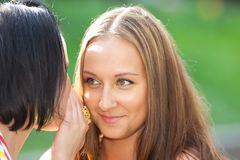 Two beauty woman talk a secret Royalty Free Stock Photography