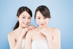 Two beauty woman. Two beauty women with healthy skin care on the blue background Stock Photography