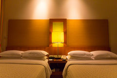 Two bed, pillow and blanket in bedroom at night Royalty Free Stock Photo