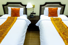 Two beds bedroom with bedside table Stock Photography