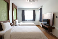 Two beds bedroom interior. Two beds with bedside table and lamp Stock Photography
