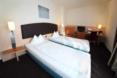 Two beds in hotel room stock photos