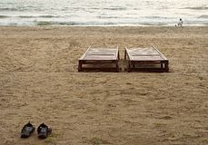 Two beds , two shooth on ocean beach Stock Images