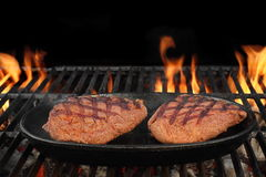 Two Beef Steaks On The Hot BBQ Flaming Grill Royalty Free Stock Images