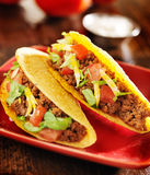 Two beef tacos with cheese, lettuce and tomatoes Stock Photo