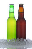 Two Beer Bottles in Ice with Condensation Royalty Free Stock Photo